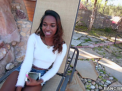 Flirty ebony pornstar with natural tits gets drilled outdoors until orgasm