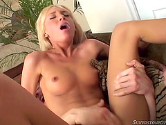 Thong-clad blonde with a beautiful body enjoying a hardcore threesome