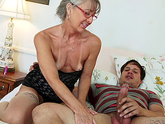 Tattooed granny loves to fuck younger studs hardcore