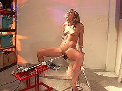 Adorable blonde orgasms strongly with a giant machine fills her holes