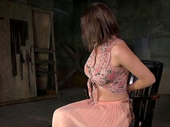 Busty woman enjoys being fucked during a BDSM session