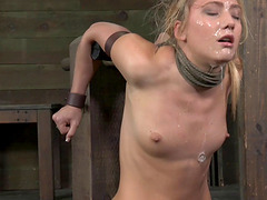 Restrained blonde's eyes tear up as she takes a rod deep in her throat