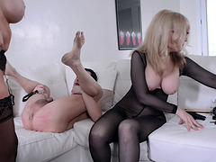 Nina Hartley and a hot redhead play with their sex slave