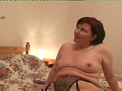 Undressing a mature redhead to usurp her experienced pussy