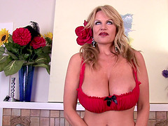 Kelly Madison takes off her red lingerie for a masturbation game