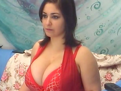 Sexy brunette in red lingerie shows off her huge boobs to the camera
