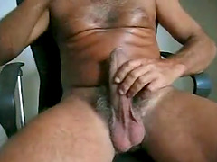 Two short but hot scenes of a hung white daddy blasting two huge cumloads.
