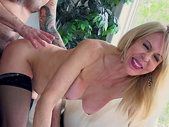 Blonde Erica Lauren fucks on the couch while she moans loudly