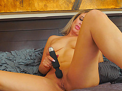 Blonde MILF Elle plays with a vibrator on her tits and pussy