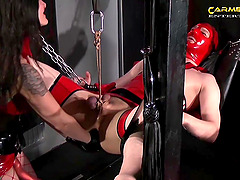 Dominant Carmen Rivera in latex adores spanking and BDSM threesome
