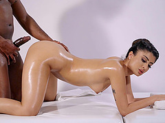Amazing interracial sex on the massage table with Marina Maya
