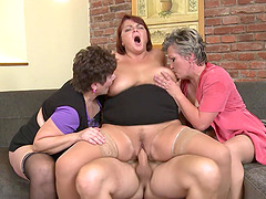 Younger guy gets his dick sucked by three cock hungry sluts