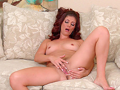 Closeup video of redhead Alicia Silver pleasuring her cravings