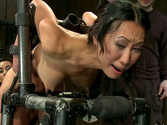 Tia Ling gets fucked with strap on in hot BDSM action