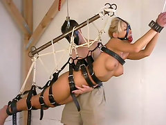 Belted blondie gets gagged and suspended