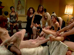 A Dozen of Girls Playing with a Submissive One in Lesbian BDSM Gangbang