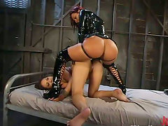 Booty girl in latex penetrates the other chick doggy style