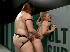 Fat bitch bangs her opponent with a huge strapon