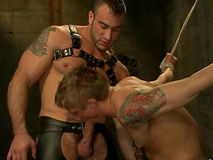 Handsome gay gets his ass toyed and fucked hard in BDSM scene