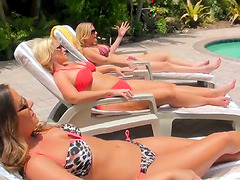 Three hot milfs play with each other's pussies on the poolside